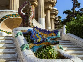 The ceramic dragon fountain in the Parc Guell designed by Antoni Gaudi, Barcelona, Spain.