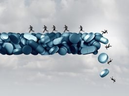 Opioid health risk and medical crisis with a prescription painkiller addiction epidemic represented by a group of people running away from a dangerous falling bridge of pills as a medicine addict problem.