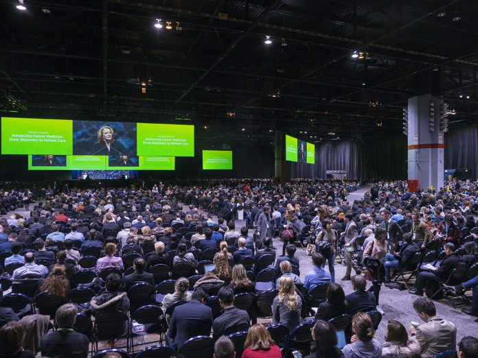 In better times: the AACR annual meeting opening plenary session in 2018 at the McCormick Convention Center in Chicago, Illinois with the 2019 president-elect Elaine Mardis, Ph.D, who served as program committee chair for this 2018 meeting, addressed attendees. Photo Courtesy © AACR/Todd Buchanan.